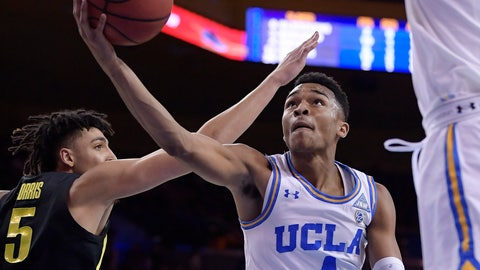 <p>               UCLA guard Jaylen Hands, right, shoots as Oregon forward Miles Norris defends during the second half of an NCAA college basketball game Saturday, Feb. 23, 2019, in Los Angeles. UCLA won 90-83. (AP Photo/Mark J. Terrill)             </p>