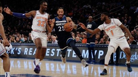 <p>               Minnesota Timberwolves' Derrick Rose (25) drives between New York Knicks' Noah Vonleh (32) and Emmanuel Mudiay (1) during the first half of an NBA basketball game Friday, Feb. 22, 2019, in New York. (AP Photo/Frank Franklin II)             </p>