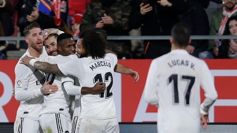 <p>               Real Madrid's Benzema, second left, celebrates with teammates after scoring during a Spanish Copa del Rey soccer match between Girona and Real Madrid at the Montilivi stadium in Girona, Spain, Thursday, Jan. 31, 2019. (AP Photo/Manu Fernandez)             </p>