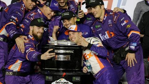 <p>               Denny Hamlin, center front, poses for a photo with his crew members after winning the NASCAR Daytona 500 auto race at Daytona International Speedway, Sunday, Feb. 17, 2019, in Daytona Beach, Fla. (AP Photo/Terry Renna)             </p>