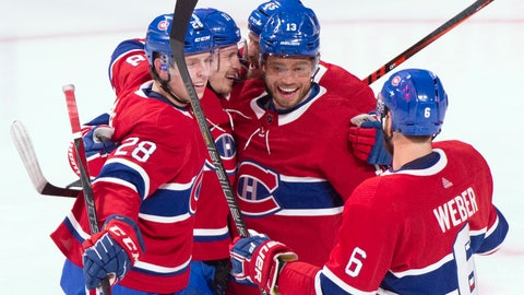 <p>               Teammates gather around Montreal Canadiens' Brendan Gallagher (11) to celebrate his hat trick during the second period of an NHL hockey game against the Philadelphia Flyers on Thursday, Feb. 21, 2019, in Montreal. (Paul Chiasson/The Canadian Press via AP)             </p>