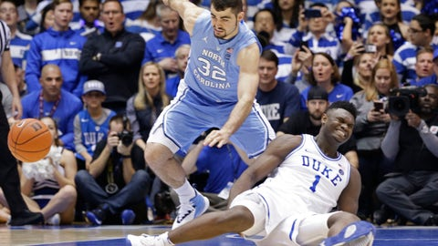 <p>               Duke's Zion Williamson (1) falls to the floor with an injury while chasing the ball with North Carolina's Luke Maye (32) during the first half of an NCAA college basketball game in Durham, N.C., Wednesday, Feb. 20, 2019. (AP Photo/Gerry Broome)             </p>
