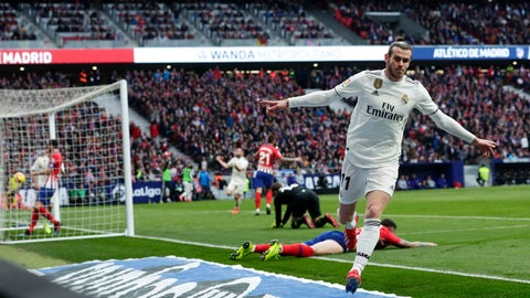 <p>               Real Madrid's Gareth Bale celebrates after scoring his side's 3rd goal during a Spanish La Liga soccer match between Atletico Madrid and Real Madrid at the Metropolitano stadium in Madrid, Spain, Saturday, Feb. 9, 2019. (AP Photo/Manu Fernandez)             </p>