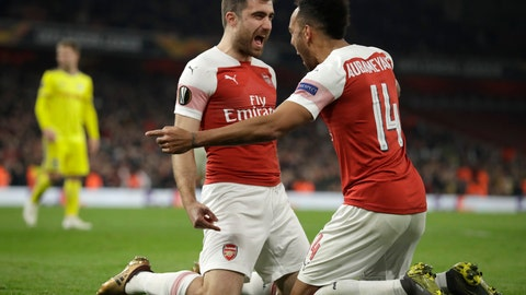 <p>               Arsenal's Sokratis Papastathopoulos, left, celebrates with Arsenal's Pierre-Emerick Aubameyang after scoring his side's third goal during the Europa League round of 32 second leg soccer match between Arsenal and Bate at the Emirates stadium in London, Thursday, Feb. 21, 2019. (AP Photo/Matt Dunham)             </p>