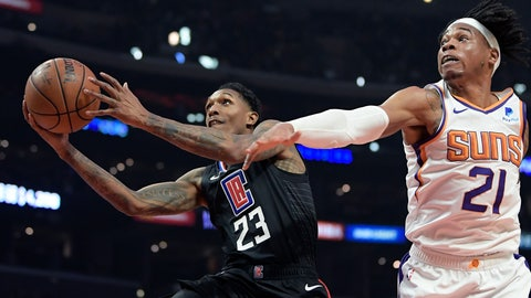 <p>               Los Angeles Clippers guard Lou Williams, left, shoots as Phoenix Suns forward Richaun Holmes defends during the first half of an NBA basketball game Wednesday, Feb. 13, 2019, in Los Angeles. (AP Photo/Mark J. Terrill)             </p>