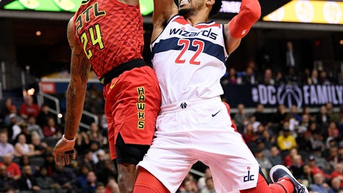 <p>               Atlanta Hawks guard Kent Bazemore (24) fouls Washington Wizards forward Otto Porter Jr. (22) as he goes to the basket during the second half of an NBA basketball game, Monday, Feb. 4, 2019, in Washington. The Hawks won 137-129. (AP Photo/Nick Wass)             </p>