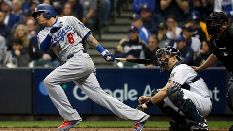<p>               FILE - In this Oct. 20, 2018, file photo, then-Los Angeles Dodgers' Manny Machado (8) hits a single during the fourth inning of Game 7 of the National League Championship Series baseball game against the Milwaukee Brewers, in Milwaukee. A person familiar with the negotiations tells The Associated Press that infielder Manny Machado has agreed to a $300 million, 10-year deal with the rebuilding San Diego Padres, the biggest contract ever for a free agent. The person spoke to the AP on condition of anonymity Tuesday, Feb. 19, 2019,  because the agreement was subject to a successful physical and had not been announced.(AP Photo/Jeff Roberson, File)             </p>
