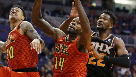 <p>               Atlanta Hawks center Dewayne Dedmon (14) grabs a rebound in front of Phoenix Suns center Deandre Ayton (22) and Hawks forward John Collins, left, during the first half of an NBA basketball game Saturday, Feb. 2, 2019, in Phoenix. (AP Photo/Ross D. Franklin)             </p>