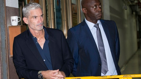 <p>               Former Australian soccer national team member Craig Foster, left, and Vice President of FIFPro Francis Awaritefe wait to meet detained Bahraini soccer player Hakeem al-Araibi as he arrives at the criminal court in Bangkok, Thailand, Monday, Feb. 4, 2019. Al-Araibi who has refugee status in Australia pleaded outside a Bangkok court on Monday for Thailand to not send him home to Bahrain, which is seeking his extradition to serve a prison sentence for a crime he denies. (AP Photo/Sakchai Lalit)             </p>