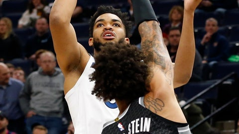 <p>               Minnesota Timberwolves' Karl-Anthony Towns, left, shoots over Sacramento Kings' Willie Cauley-Stein in the first half of an NBA basketball game Monday, Feb. 25, 2019, in Minneapolis. (AP Photo/Jim Mone)             </p>