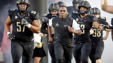 <p>               FILE - In this Sept. 1, 2018, file photo, Vanderbilt coach Derek Mason, center, runs onto the field with his team before its opening game of the NCAA college football season, against Middle Tennessee, in Nashville, Tenn. New Vanderbilt athletic director Malcolm Turner has extended the contract for coach Derek Mason after the Commodores reached a second bowl game in three seasons. Turner also announced Friday, Feb. 22, 2019, extensions for men's golf coach Scott Limbaugh and bowling coach John Williamson.(AP Photo/Mark Humphrey, File)             </p>