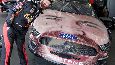 <p>               Corey LaJoie leans over the hood of his car with a likeness of him painted on the front end before a practice session for the NASCAR Daytona 500 auto race at Daytona International Speedway, Friday, Feb. 15, 2019, in Daytona Beach, Fla. (AP Photo/John Raoux)             </p>