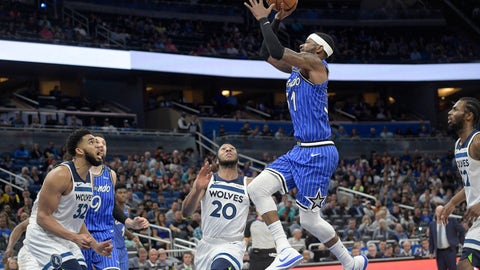 <p>               Orlando Magic guard Terrence Ross (31) goes up for a shot between Minnesota Timberwolves center Karl-Anthony Towns (32), guard Josh Okogie (20) and forward Andrew Wiggins (22) during the second half of an NBA basketball game Thursday, Feb. 7, 2019, in Orlando, Fla. (AP Photo/Phelan M. Ebenhack)             </p>