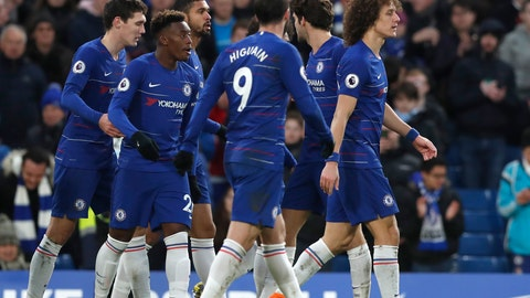 Chelsea's David Luiz right celebrates with teammates after scoring his side's fifth goal during the English Premier League soccer match between Chelsea and Huddersfield Town at Stamford Bridge stadium in London Britain Saturda