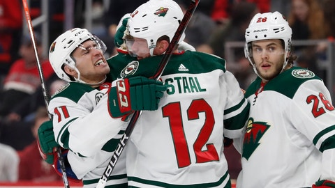 <p>               Minnesota Wild center Eric Staal (12) is congratulated by teammate left wing Zach Parise (11) after scoring during the second period of the team's NHL hockey game against the Detroit Red Wings, Friday, Feb. 22, 2019, in Detroit. (AP Photo/Carlos Osorio)             </p>