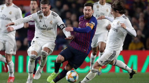 <p>               Barcelona forward Lionel Messi, center, Real defender Sergio Ramos, left, and Real midfielder Luka Modric, right, vie for the ball during the Copa del Rey semifinal first leg soccer match between FC Barcelona and Real Madrid at the Camp Nou stadium in Barcelona, Spain, Wednesday Feb. 6, 2019. (AP Photo/Emilio Morenatti)             </p>