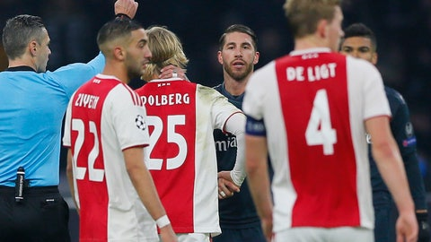 <p>               This Wednesday Feb. 13, 2019, image shows referee Damir Skomina, left, showing a yellow card to Real's Sergio Ramos, center, after a foul on Ajax's Kasper Dolberg during the first leg, round of sixteen, Champions League soccer match between Ajax and Real Madrid at the Johan Cruyff ArenA in Amsterdam, Netherlands. UEFA is investigating reported comments by Real Madrid captain Sergio Ramos that he intentionally got a yellow card to provoke a favorable Champions League ban. (AP Photo/Peter Dejong)             </p>