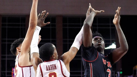 <p>               Utah forward Donnie Tillman, right, shoots as Southern California forward Bennie Boatwright, left, and guard Shaqquan Aaron defend during the first half of an NCAA college basketball game Wednesday, Feb. 6, 2019, in Los Angeles. (AP Photo/Mark J. Terrill)             </p>