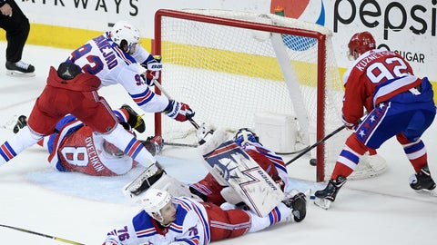 <p>               Washington Capitals center Evgeny Kuznetsov (92), of Russia, scores the game-winning goal during overtime of an NHL hockey game against New York Rangers center Mika Zibanejad (93), defenseman Brady Skjei (76), and goaltender Henrik Lundqvist, second from right, , of Sweden, Sunday, Feb. 24, 2019, in Washington. Also seen is Capitals left wing Alex Ovechkin (8), , of Russia. The Capitals won 6-5 in overtime. (AP Photo/Nick Wass)             </p>