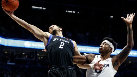 <p>               DePaul's Jaylen Butz (2) rebounds against Xavier's Tyrique Jones, right, during the first half of an NCAA college basketball game, Saturday, Feb. 9, 2019, in Cincinnati. (AP Photo/John Minchillo)             </p>