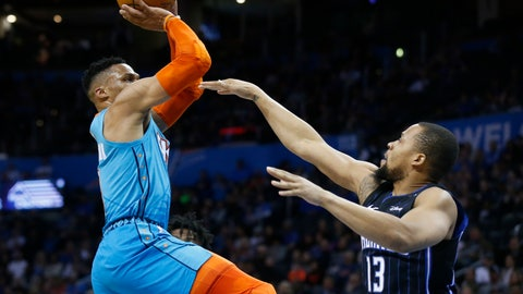 <p>               Oklahoma City Thunder guard Russell Westbrook, left, shoots over Orlando Magic guard Isaiah Briscoe (13) during the first half of an NBA basketball game in Oklahoma City, Tuesday, Feb. 5, 2019. (AP Photo/Sue Ogrocki)             </p>
