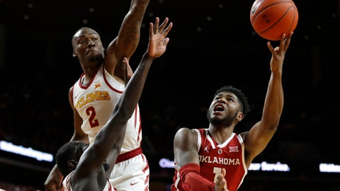 <p>               Oklahoma guard Rashard Odomes, right, shoots over Iowa State's Marial Shayok and Cameron Lard (2) during the first half of an NCAA college basketball game, Monday, Feb. 25, 2019, in Ames, Iowa. (AP Photo/Charlie Neibergall)             </p>