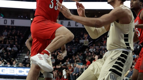 <p>               Louisville's Jordan Nwora (33) goes up to the basket as Wake Forest's Olivier Sarr defends during the first half of an NCAA college basketball game in Winston-Salem, N.C., Wednesday, Jan. 30, 2019. (AP Photo/Chuck Burton)             </p>