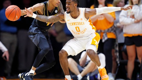 <p>               Tennessee guard Jordan Bone (0) attempts to steal the ball from Missouri guard Xavier Pinson (1) during the first half of an NCAA college basketball game Tuesday, Feb. 5, 2019, in Knoxville, Tenn. (AP photo/Wade Payne)             </p>
