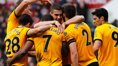 <p>               Wolverhampton players celebrate after Ivan Cavaleiro, center left, scored the opening goal during the English FA Cup fifth round soccer match between Bristol City and Wolverhampton Wanderers at Ashton Gate stadium in Bristol, England, Sunday, Feb. 17, 2019. (AP Photo/Frank Augstein)             </p>