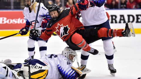 <p>               Canada forward Ann-Sophie Bettez (39) is pushed over U.S. goalie Katie Burt (41) after Canada scored during the first period of a Rivalry Series hockey game Thursday, Feb. 14, 2019, in Toronto. (Frank Gunn/The Canadian Press via AP)             </p>