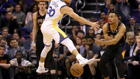 <p>               Phoenix Suns guard Elie Okobo, right, passes underneath a jumping Golden State Warriors guard Stephen Curry (30) during the first half of an NBA basketball game Friday, Feb. 8, 2019, in Phoenix. (AP Photo/Ross D. Franklin)             </p>