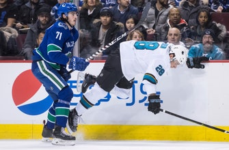Kane scores twice, Sharks rout Canucks 7-2