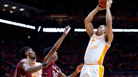<p>               Tennessee forward Grant Williams (2) shoots over South Carolina guard A.J. Lawson (00) and forward Chris Silva (30) during the second half of an NCAA college basketball game Wednesday, Feb. 13, 2019, in Knoxville, Tenn. Tennessee won 85-73. (AP photo/Wade Payne)             </p>