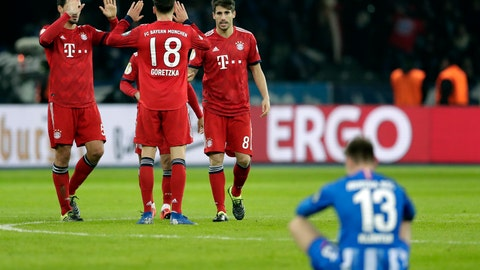 <p>               Hertha's Lukas Kluenter sits on the pitch as Bayern's players celebrate after a German Soccer Cup round of sixteen match between Hertha BSC Berlin and FC Bayern Munich in Berlin, Germany, Wednesday, Feb. 6, 2019. Munich defeated Berlin by 3-2. (AP Photo/Michael Sohn)             </p>