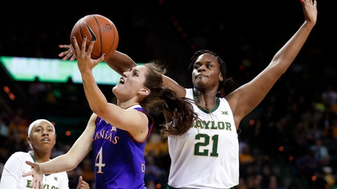 <p>               Kansas forward Mariane de Carvalho (4) goes up for a shot that was blocked by Baylor's Kalani Brown (21) during the first half of an NCAA college basketball game in Waco, Texas, Wednesday, Feb. 20, 2019. (AP Photo/Tony Gutierrez)             </p>