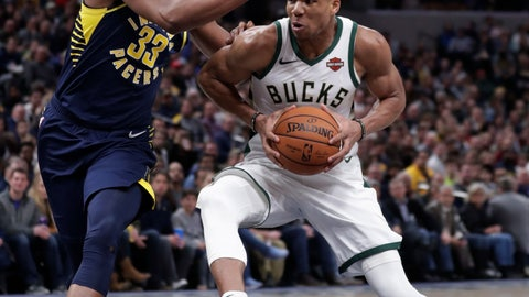 <p>               Milwaukee Bucks forward Giannis Antetokounmpo (34) drives on Indiana Pacers center Myles Turner (33) during the second half of an NBA basketball game in Indianapolis, Wednesday, Feb. 13, 2019. The Bucks defeated the Pacers 106-97. (AP Photo/Michael Conroy)             </p>