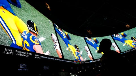 <p>               A man watches Super Bowl LIII at the Westgate Superbook sports book, Sunday, Feb. 3, 2019, in Las Vegas. (AP Photo/John Locher)             </p>