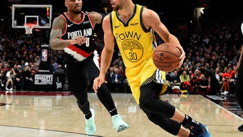 <p>               Golden State Warriors guard Stephen Curry, right, drives to the basket past Portland Trail Blazers guard Damian Lillard during the first half of an NBA basketball game in Portland, Ore., Wednesday, Feb. 13, 2019. (AP Photo/Steve Dykes)             </p>