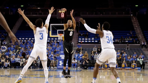 <p>               Colorado guard Shane Gatling (0) makes a 3-point basket over UCLA guard Jules Bernard (3) and guard David Singleton (34) during the first half of an NCAA college basketball game Wednesday, Feb. 6, 2019, in Los Angeles. (AP Photo/Marcio Jose Sanchez)             </p>