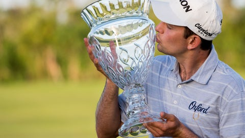 <p>               Martin Trainer of California kisses the championship cup after winning the Puerto Rico Open PGA golf tournament in Rio Grande, Puerto Rico, Sunday, Feb. 24, 2019. (AP Photo/Carlos Giusti)             </p>