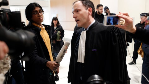 <p>               Plaintiffs' lawyer Jean-Philippe Morel answers media at the Paris' courthouse, ahead of the opening hearing of Christophe Dettinger's trial, in Paris, Wednesday, Feb. 13, 2019. A former boxing pro and suspected of viciously attacking riot police officers with his fists and feet during the yellow vest protests in France is going on trial on charges. (AP Photo/Thibault Camus)             </p>