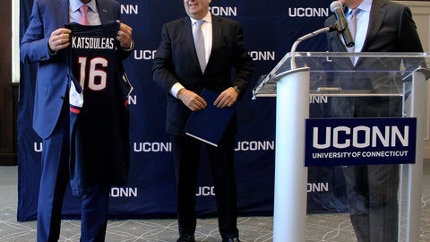 <p>               Thomas C. Katsouleas, left, is presented with a UConn basketball jersey by University of Connecticut Board of Trustees chairman Thomas Kruger, center, and Connecticut Gov. Ned Lamont after being appointed as the University of Connecticut's 16th president on Tuesday, Feb. 5, 2019 in Storrs, Conn. (AP Photo/Pat Eaton-Robb)             </p>