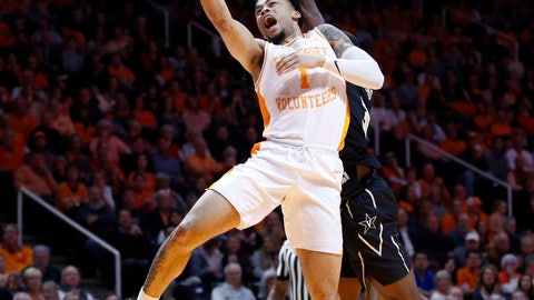 <p>               Tennessee guard Lamonte Turner (1) goes for a shot as he's fouled by Vanderbilt guard Maxwell Evans during the first half of an NCAA college basketball game Tuesday, Feb. 19, 2019, in Knoxville, Tenn. (AP photo/Wade Payne)             </p>