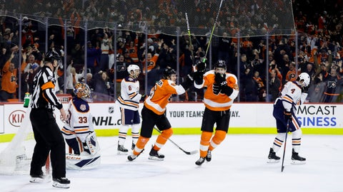 <p>               Philadelphia Flyers' James van Riemsdyk (25) and Travis Sanheim (6) celebrate past Edmonton Oilers' Kris Russell (4), Ty Rattie (8) and Cam Talbot (33) after Nolan Patrick scored the game-winning goal during overtime in an NHL hockey game, Saturday, Feb. 2, 2019, in Philadelphia. Philadelphia won 5-4.(AP Photo/Matt Slocum)             </p>