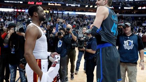 <p>               Miami Heat's Dwyane Wade, left, and Dallas Mavericks' Dirk Nowitzki, right, talk as they swap jerseys after an NBA basketball game in Dallas, Wednesday, Feb. 13, 2019. (AP Photo/Tony Gutierrez)             </p>