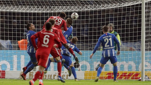 <p>               Bayern's Kingsley Coman, center, scores his side's 3rd goal during a German Soccer Cup round of sixteen match between Hertha BSC Berlin and FC Bayern Munich in Berlin, Germany, Wednesday, Feb. 6, 2019. (AP Photo/Michael Sohn)             </p>