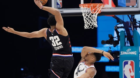 <p>               Team LeBron's Karl-Anthony Towns, of the Minnesota Timberwolves, heads to the hoop against Team Giannis' Giannis Antetokounmpo, of the Milwaukee Bucks, during the first half of an NBA All-Star basketball game, Sunday, Feb. 17, 2019, in Charlotte, N.C. (AP Photo/Chuck Burton)             </p>