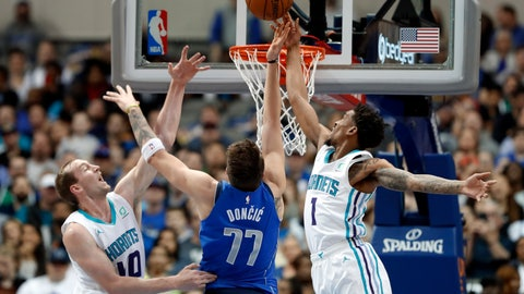 <p>               Dallas Mavericks forward Luka Doncic (77) has his shot blocked by Charlotte Hornets' Malik Monk (1) as center Cody Zeller, left, helps defend during the first half of an NBA basketball game in Dallas, Wednesday, Feb. 6, 2019. (AP Photo/Tony Gutierrez)             </p>