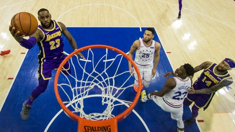 <p>               Los Angeles Lakers' LeBron James, left, goes up for the shot as Philadelphia 76ers' Ben Simmons, center, of Australia, and Jimmy Butler, right, look on during the second half of an NBA basketball game, Sunday, Feb. 10, 2019, in Philadelphia. The 76ers won 143-120. (AP Photo/Chris Szagola)             </p>