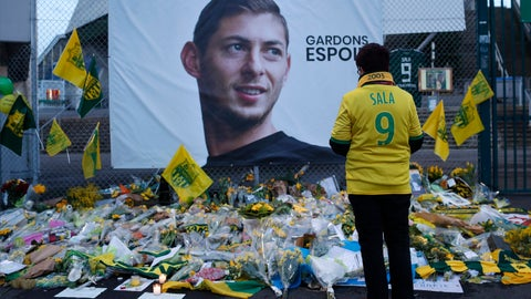 """<p>               FILE - In this Wednesday, Jan. 30, 2019, file photo, a Nantes soccer team supporters stops by a poster of Argentinian player Emiliano Sala and reading """"Let's keep hope"""" outside La Beaujoire stadium before the French soccer League One match Nantes against Saint-Etienne, in Nantes, western France. On Sunday, Feb. 3, 2019, the man leading a private search for the missing plane carrying Argentine soccer player Emiliano Sala says the wreckage has been found. (AP Photo/Thibault Camus, File)             </p>"""